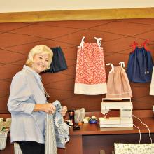 Linda Whittington and a few dresses. undefined