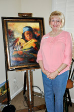 Lorretta Johnson and her oil painting undefined