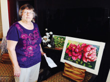 Sharon Morey and her watercolor painting undefined