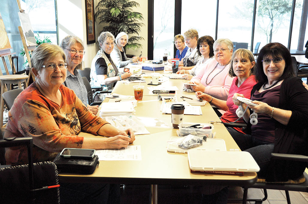 The members of the Beading Club are working on their own projects: Martha Sampson, Debbie Weinenger, Judy Verbeke, Donna Norris, Raynelle Duhl, Vivian Dohms, Jan Larkey, Sharon Marchant, Barb Martin and Chris Nunamaker. undefined