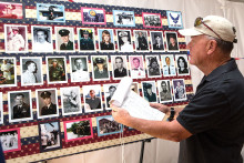 Former Marine Mark Morgan comparing the list of names on the clipboard to the pictures. undefined