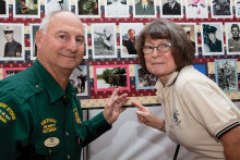 Deena Robinson and her husband former Lt. Colonel Ken Robinson, who spent 36 years in the army, pointing to Ken's picture. undefined