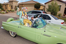 A surprise parade entry by a Mr. Ed Robson imposter Paul Lapotosky in a lime green T-Bird driven by Steve Garceau. undefined