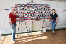 Carol Andrews and Chris Seifert standing alongside the Veterans Honor Board they both prepared. undefined