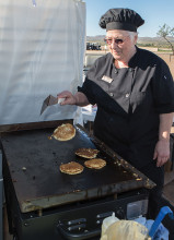 Mary Le Compte flipping pancakes on the newly purchased griddle. undefined