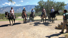 From right are Vicki Pitts—owner of Pusch Ridge Stables, Bev Hall, Jeanne Bianchini, Rebecca Williams, Don Williams and Mary Theis returning from a ride through the foothills of the Catalina Mountains at Pusch Ridge Stables. undefined