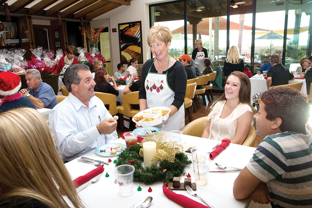 Colleen Carey serving appetizers to Alex Meece, a very happy Tim Fudge, Director of Facilities and Operations, Andrea Marchus, Administration and Facilities Coordinator and Ray Parham undefined
