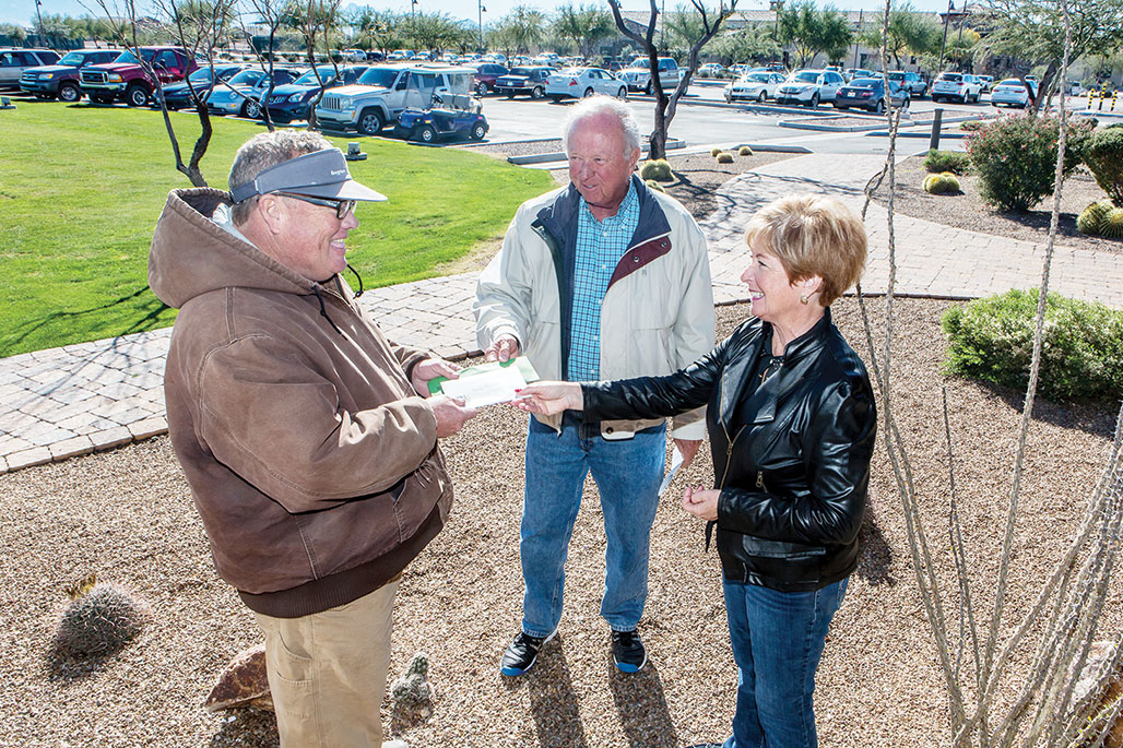 Jack Gressingh and Colleen Carey presenting a check to Jeff Mitchell, the golf course maintenance manager, from the residents at SaddleBrooke Ranch. It's an appreciation check for all their hard work and dedication towards giving us a course to be proud of. undefined