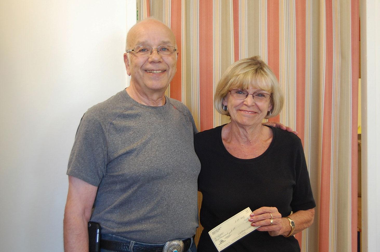 Arthur Posner gives check to SBCO President Joan Roberts.