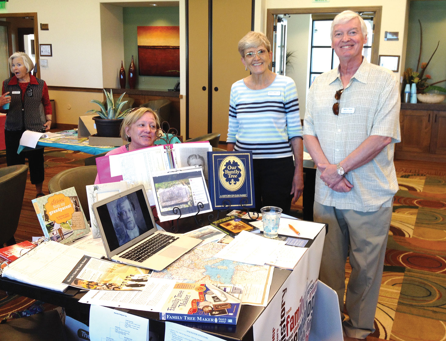 Rebecca Williams, Wendy MacMillian and Mike Neal at the genealogy table