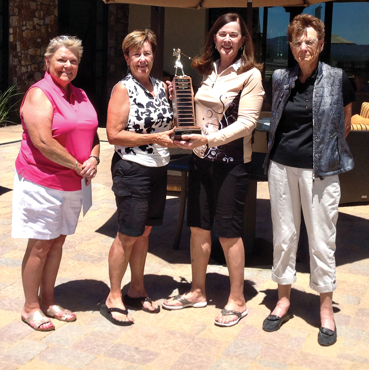Left to right: Charlene Culver; Mary Snowden, club champion; Brenda Armenia, president; and June Nichols