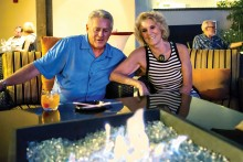 Steve and Judy Andrasic sitting behind the fire pit
