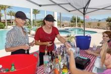 Marlene Diskin-Bratz and Jeanne Osterlund getting liquid refreshments