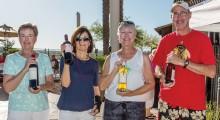 Marlene Jolly, Lynn Fidler, Deb Lawson and Jim Carstens who won bottles of wine.