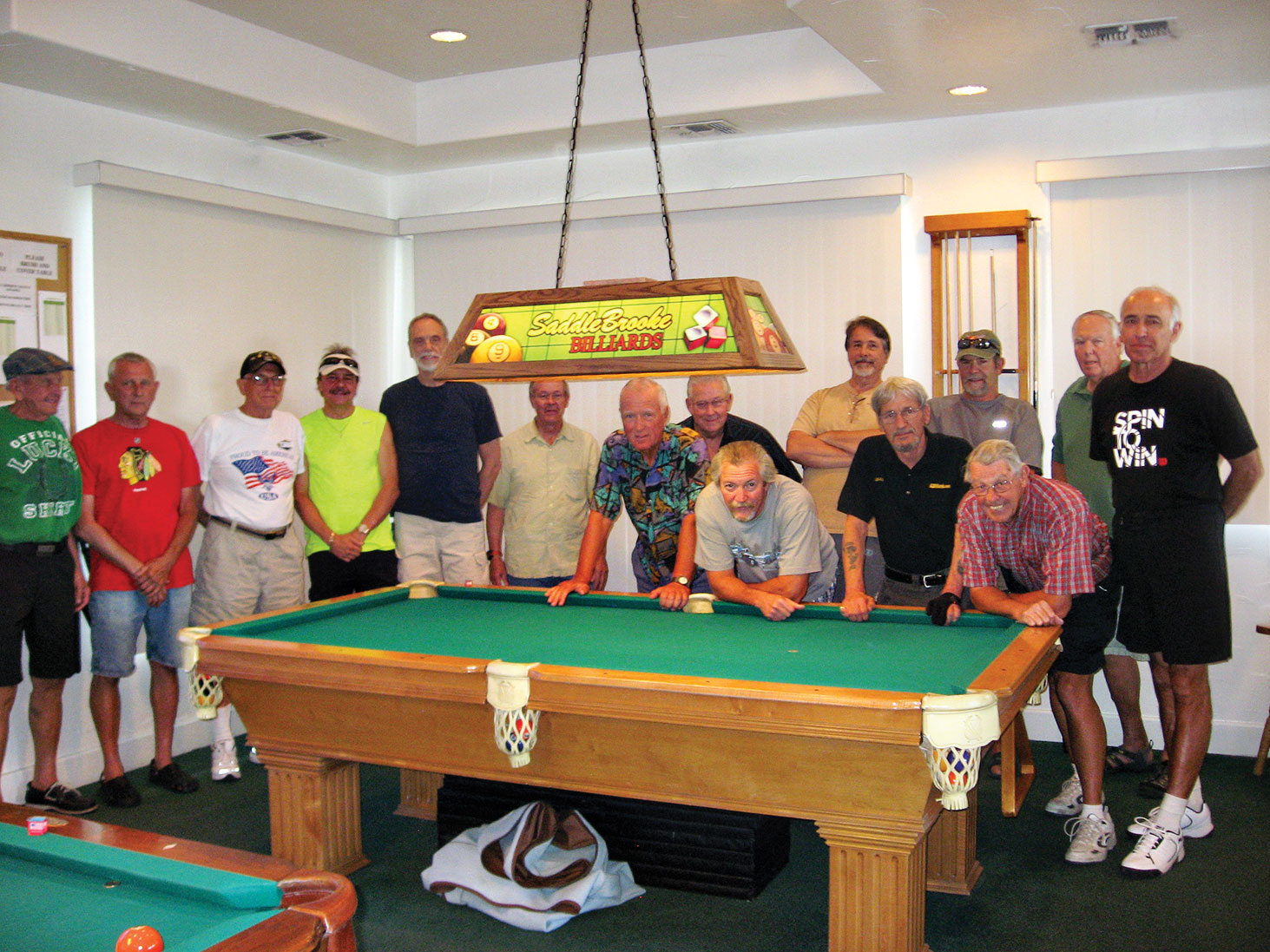 "The 16 participants, left to right: Cliff ""Lucky Shirt"" Terry, Tom ""Ski"" Kaliski, Al ""Big Al"" Petito, Paul ""Bankster"" Callas, Jim ""Aviator"" Wydick, Dave Brinker, Richard ""Loose Rack"" Galant, Tom ""Teck"" Sorensen, Dominic ""The Doctor"" Borland, Tom ""Half Jacket"" Barrett, Joe ""Fast Eddie"" Giammarino, Jim Kaufman, Don ""Deadeye"" Cox, Dan Stebbins and Jim ""Shooter"" Fabio. Richard ""Villa Park"" Werkmeister is not pictured."