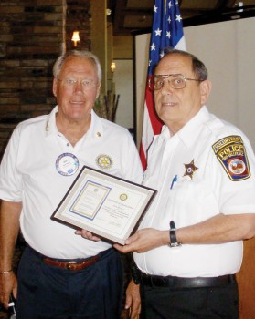 Neil Deppe presents speaker Bob Milkey from Oro Valley Police Citizen Volunteer Assistants Program with an appreciation plaque.