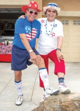 Bob Johnson and Jan Christenson showing holiday socks