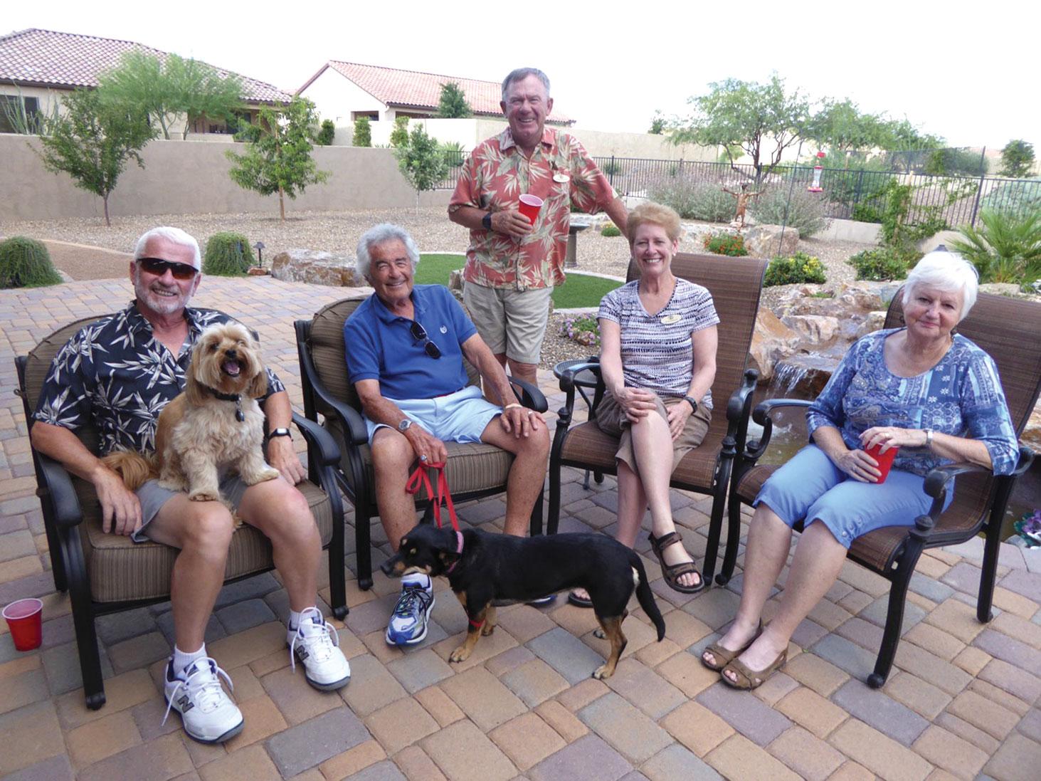 Yard hosts: Gene Lawrence on the left and Carol Lawrence on the right; nibbles and beverage hosts: Jim Karp, Jean Morgan and Mark Morgan, standing