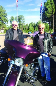 Ready to ride, Ernie and Priscilla Wolf