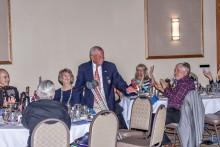 Col. Charlie Carr and head table; photography courtesy of Bill George