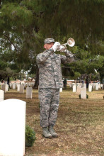Sgt. Jose Barraza playing taps on the bugle