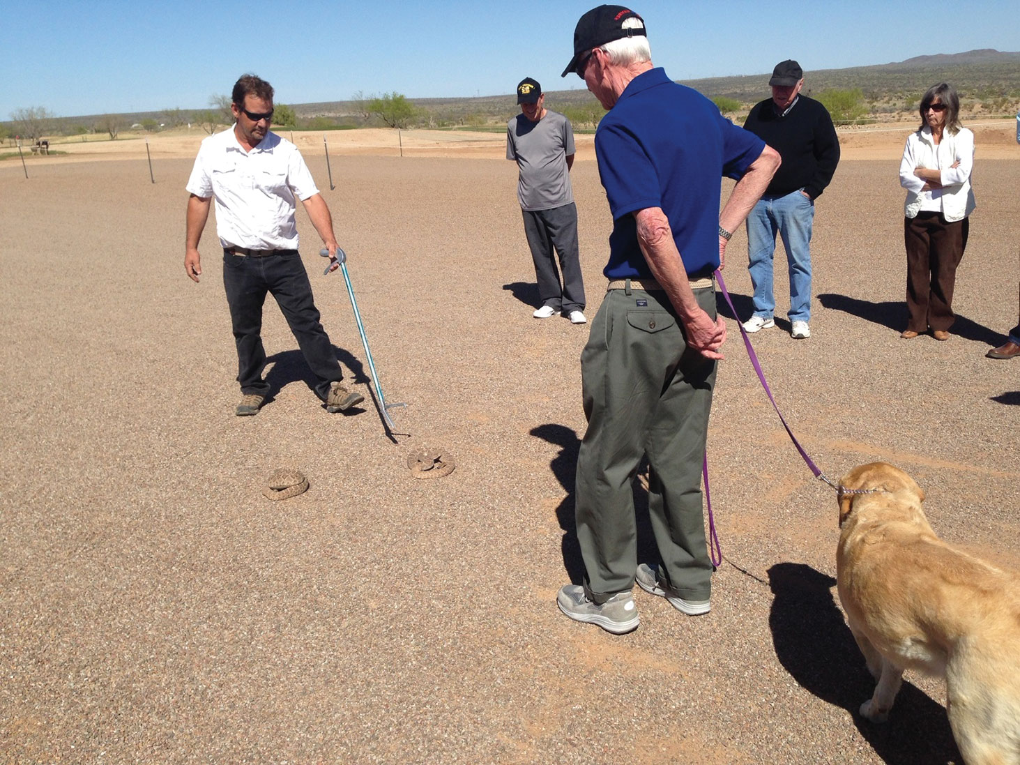 Jay Smith of Community Dog Training working with SBR resident Dale Barringer and his dog, Shasta