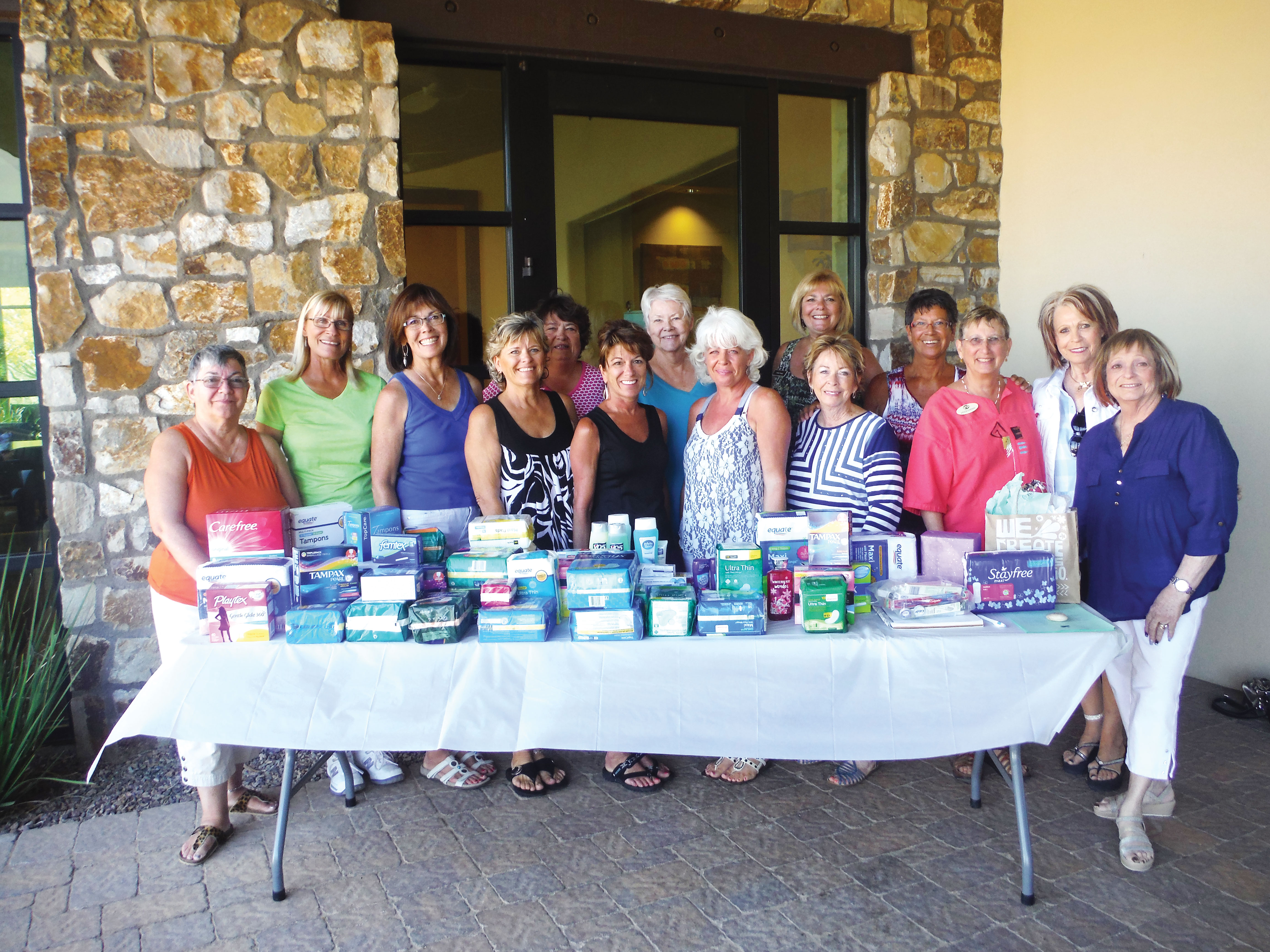 Members of Gathering Hearts and the donations they received for the YOTO program.