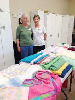 Dianne Resseguie and Marlene Jolly, both residents of SBR, admire the piles of hand-knitted items ready for delivery.