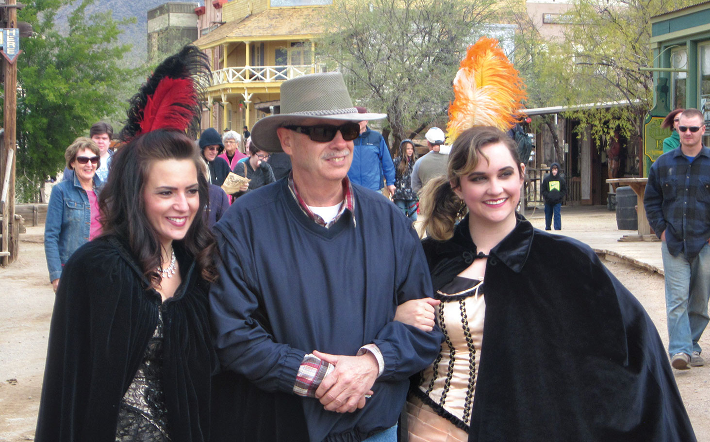 Old Tucson Street – While Linda Nicholson looks on from behind, left, Mike Nicholson enjoys the sights at Old Tucson Studios with two dance hall girls.