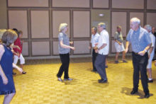 Jeanny and Wally Mara leading a Salsa class