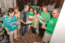 A group of guests singing Irish ditties like O Danny Boy, An Irish Lullaby, and When Irish Eyes are Smiling; photo by Steve Weiss