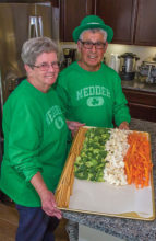 Kathy and Ernie Nedder showing a tray of vegetables in the form of an Irish flag; photo by Steve Weiss