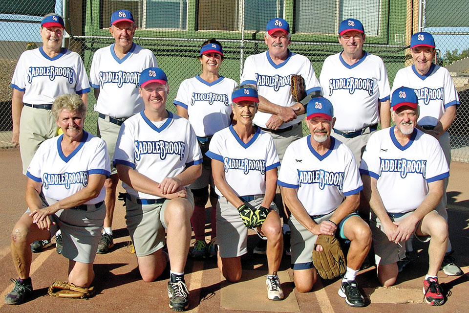 John's spring season teammates. For those who wonder if ladies play softball, please note there are four ladies on this team; add one more that was missing on photo day. Photo by Pat Tiefenbach.