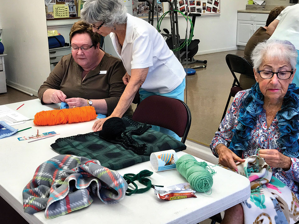Lorna is there for guidance with learning how to crochet the edges.