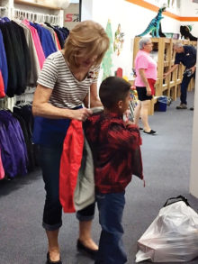"At Kids' Closet a volunteer ""personal shopper"" assists every child."