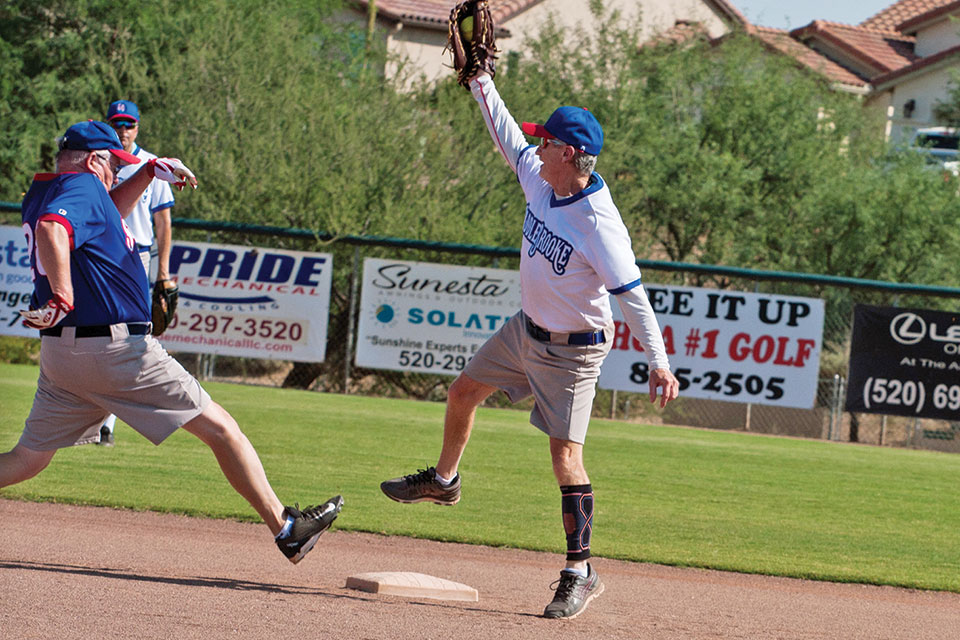 Recreation game: second baseman Dennis Purcell leaps to catch the throw as Dale Norgard stretches to reach second base safely. Photo by Cathy Purcell