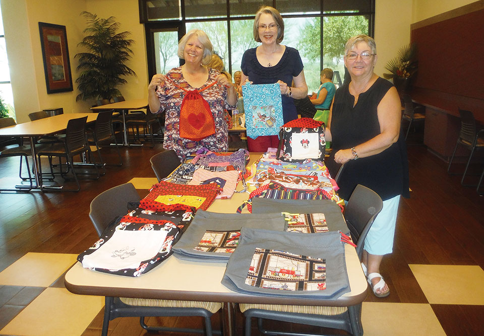 The Stitch and Chat ladies made bookbags for Oracle Elementary School.