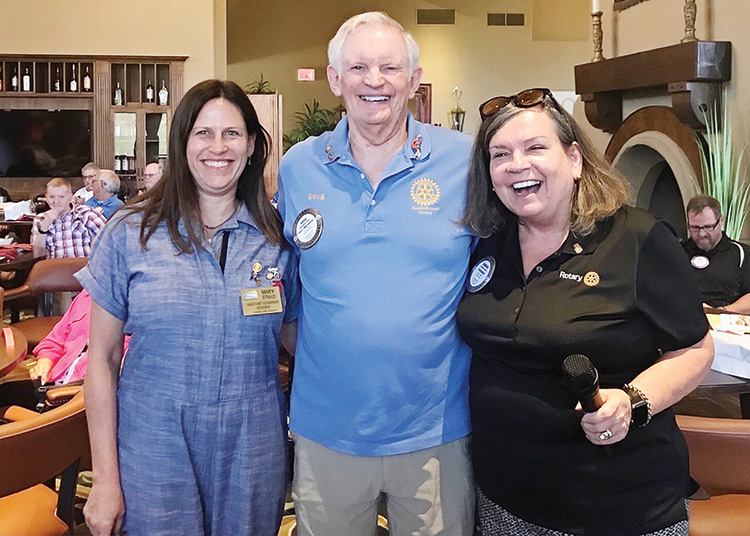 Assistant district governor, Mary Strauss, celebrates the passing of the gavel with outgoing president, Doug May, and incoming president, Barbara Barr.