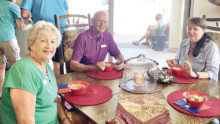 Irene and Bill Keil and Bobbie Spiegel swap Texas stories over a bowl of Blue Bell ice cream.