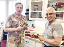"""Bob Authur and Jim Spiegel scoop up favorite Blue Bell flavors at the Texas Club """"Bluebonnets and Blue Bell"""" event."""