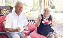 """Tony and Linda Zoellner enjoy a bowl of Blue Bell ice cream at the Texas Club event, """"Bluebonnets and Blue Bell."""""""