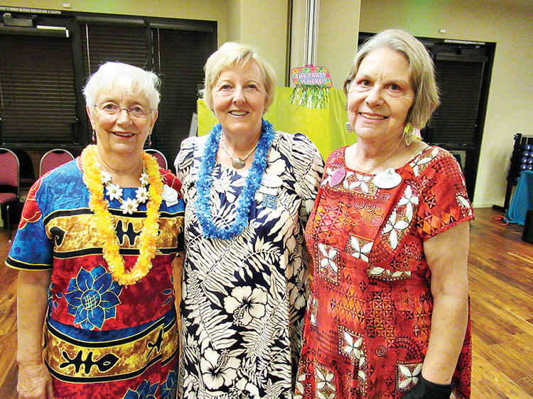 Ranchero Rebecca Williams (center) joins friends Linda Lewis (left) and Kathy Smith (right) in dancing to the music of the Islands.