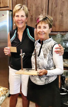 Lorraine Smith presenting the winner of the tournament, Mary Snowden, with the Telegraph trophy.