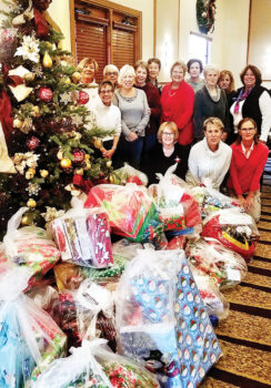 In 2018, Unit 48 volunteers gathered to wrap presents for the Outreach Adopt-a-Family and Adopt-a-Child program.