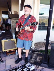 Guitarist Rick Still providing entertainment at a neighborhood party. Photo by Diane Still.