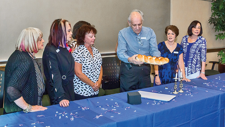 Phil Barish leads the traditional blessing over the bread.