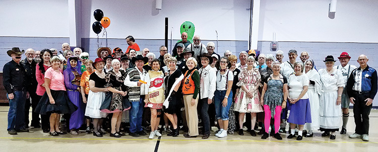 Rancheros and SaddleBrooke Squares enjoy costumes and dancing on Halloween.