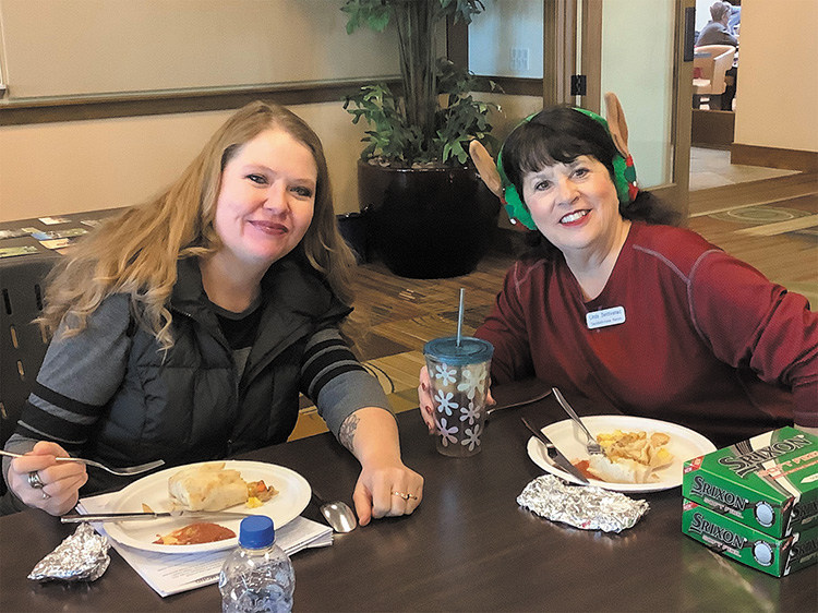 Allison Honeycutt, from Golf Cars of Arizona, enjoys brunch with Linda Santevanac, Vice President of the Ranchette Putters.