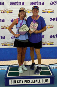Kim and partner with silver medals at Spring Slam.