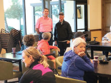 SBR golf pros, Ken Steinke and Mike Jahaske, share tips and encouragement with the Ranchette Putters; Photo by Camille Esterman.